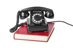 Vintage Telephone And Book Royalty Free Stock Image