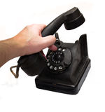 Vintage telephone being picked up Stock Image