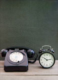 Vintage telephone, clock Royalty Free Stock Images
