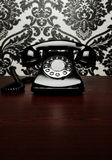 Vintage telephone at the desk Royalty Free Stock Photos