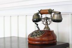 Vintage Telephone On Desk. An old vintage telephone on wooden desk Stock Photo