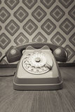 Vintage telephone on diamond wallpaper Royalty Free Stock Photography