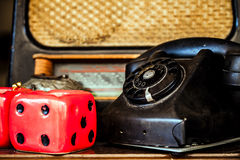 Vintage Telephone and Dice Royalty Free Stock Images