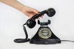 Retro Telephone, hand picking up the receiver royalty free stock images