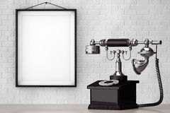 Vintage Telephone in front of Brick Wall with Blank Frame Royalty Free Stock Photo