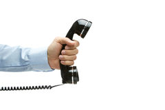 Vintage telephone in hand. Human hand holding vintage telephone, isolated on white with copy space Stock Image
