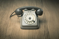 Vintage telephone on hardwood surface Royalty Free Stock Images