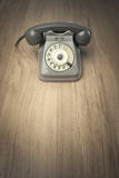 Vintage telephone on hardwood surface Royalty Free Stock Image