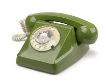 Vintage telephone isolated. Dark green vintage telephone isolated on white Royalty Free Stock Image