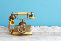 Vintage telephone. Luxury vintage telephone on white wooden classic table royalty free stock image