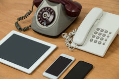 Vintage telephone, modern telephone, digital tablet and mobile phones Stock Images