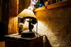 Vintage telephone and old lamp in retro style Royalty Free Stock Photos