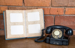 Vintage telephone. And old notebook Stock Image