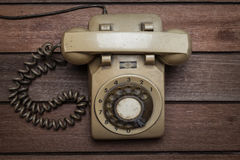 Vintage Telephone on an Old Table Royalty Free Stock Photos