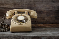 Vintage Telephone on an Old Table. Vintage Telephone on an Old Wood Table Royalty Free Stock Photo