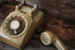 Vintage Telephone on an Old Table Stock Photo