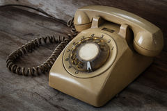 Vintage Telephone on an Old Table Stock Image