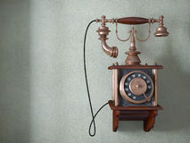 Vintage telephone on old wall Stock Photo