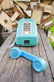 Vintage telephone on old wood table Stock Photography
