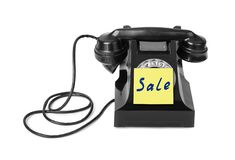 Vintage telephone and paper Sale Royalty Free Stock Image