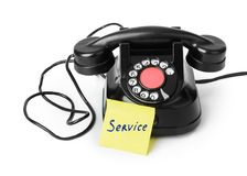 Vintage telephone and paper Service Stock Photography