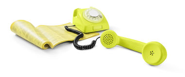 Vintage telephone and phone directory Royalty Free Stock Photo