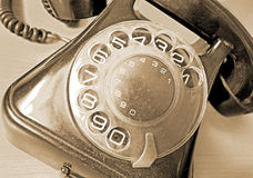Vintage telephone in sepia Stock Photo