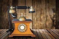 Vintage telephone on table Stock Photo