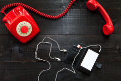Vintage telephone vs smartphone Stock Images