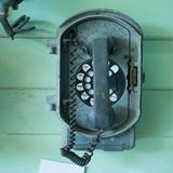 Vintage telephone on the wall Royalty Free Stock Image