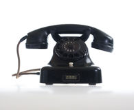 Vintage telephone on white. Black vintage phone Royalty Free Stock Photos