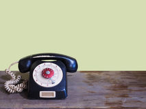 Vintage telephone on wooden table Royalty Free Stock Photo