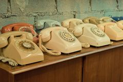 Vintage telephones on the table Stock Photos