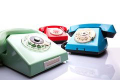Vintage telephones on white Stock Photography