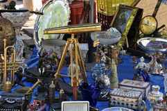 Vintage telescope antiques. Vintage telescope and antiques for sale at street market Stock Photos