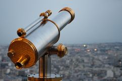 Vintage Telescope looking over city Royalty Free Stock Images