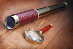 Vintage telescope and magnifier Stock Photos