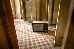 VIntage televioson on tiles Royalty Free Stock Photos