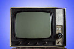 Vintage television. On blue background Royalty Free Stock Image