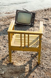 Vintage television on beach Stock Image