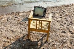 Vintage television on beach Stock Photos