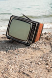 Vintage television on beach Royalty Free Stock Images