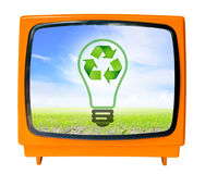 Vintage television with blue sky and recycle sign, clipping path. Eco friendly concept Stock Image