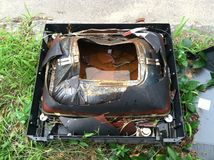 Vintage Television. Old abandoned television trashed stock photos