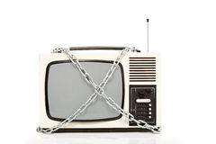 Vintage television set in chains. Censorship concept, isolated Royalty Free Stock Image