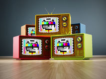 Vintage television stack standing on wood Royalty Free Stock Photography