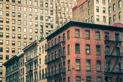Vintage New York City Apartment Buildings. Vintage tenement buildings and modern buildings in the background, New York Cityn Royalty Free Stock Image