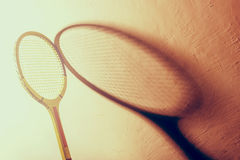 Vintage tennis racket. Backlit vintage tennis racket and its shadow Royalty Free Stock Photography
