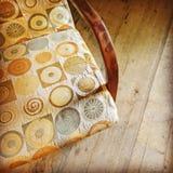 Vintage textile armchair on wooden floor Stock Photo
