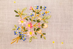 Vintage textile texture with beautiful embroidery Stock Photos